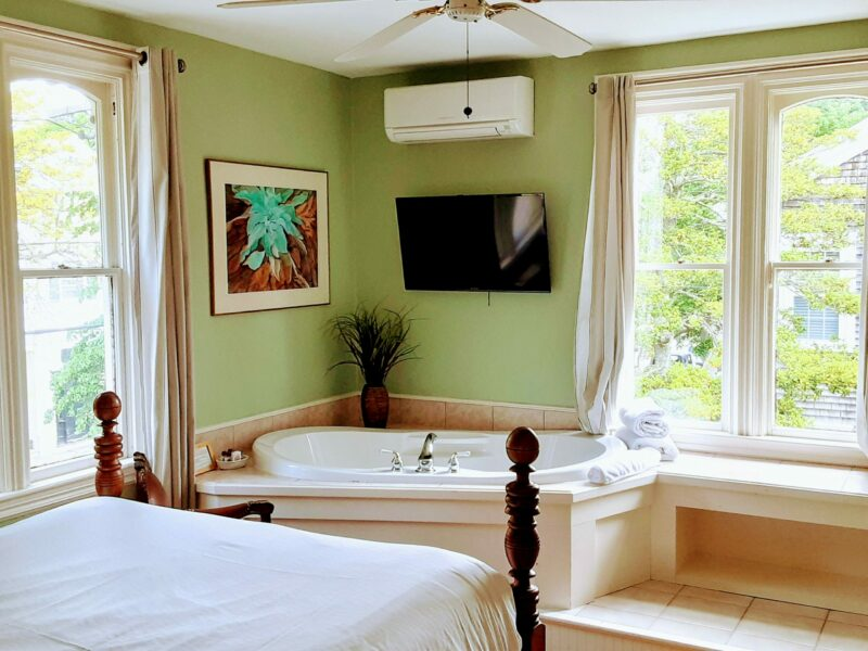 Painted Lady room 2 shows a queen bed and fireplace