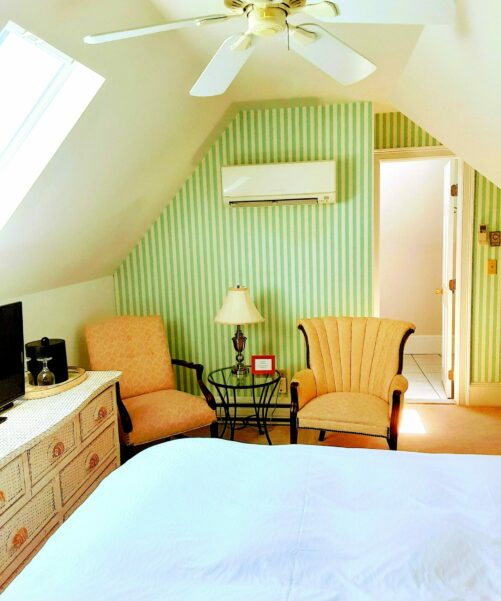 2 chairs and a table are shown in a guest bedrom