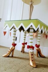 A whimsical bedside table wears golden shoes