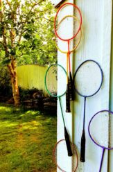 Badminton rackets hang on a shed