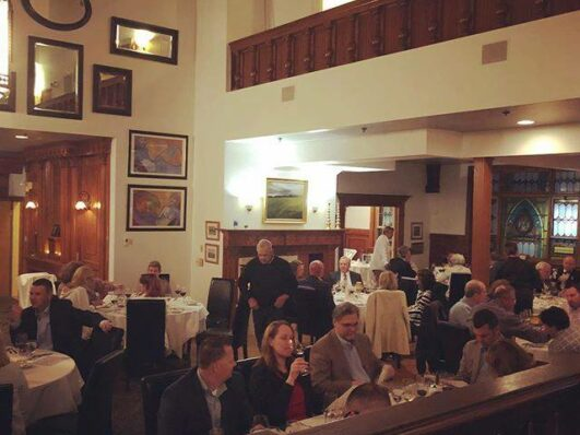 People gather inside theBelfry Bistro for an event.