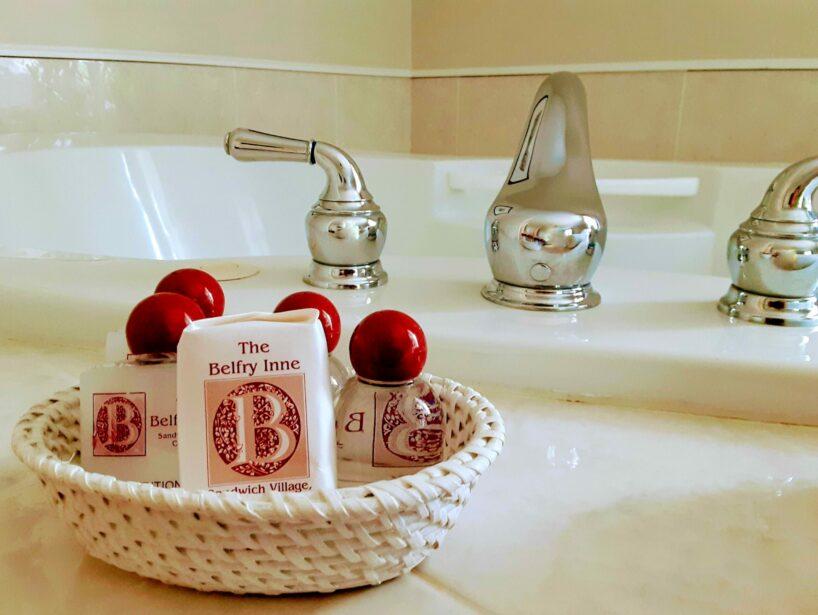 Bath amenities sit on a Jacuzzi